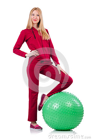 Young woman with ball exercising