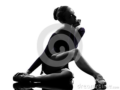 Young woman ballerina ballet dancer stretching warming up
