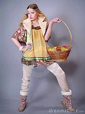 Young woman  with a basket of apples