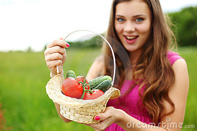 Young woman with basket of vegetables