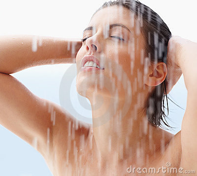 Young woman bathing under the shower