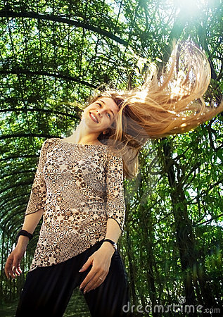 Young woman with beautiful hair in motion