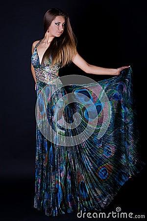 Young woman in beautiful long dress