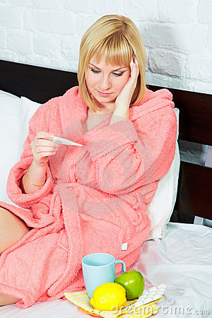 Young woman in bed having flu