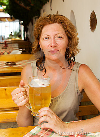 The young woman with a beer