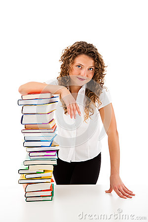Young woman behind pile of books isolated on white