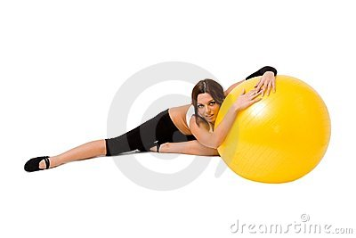 Young woman with big fitness ball