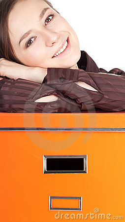 Young woman and big orange box