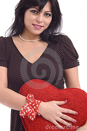 Young woman with big red plush heart