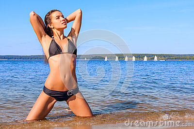Young woman in bikini on a beach