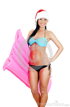 Young woman in bikini and christmas hat