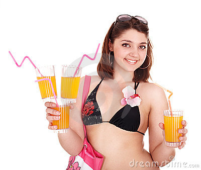 Young woman in bikini with coctail.