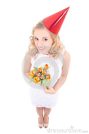 Young woman in birthday cap with flowers