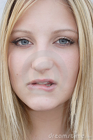 Young woman biting her lip