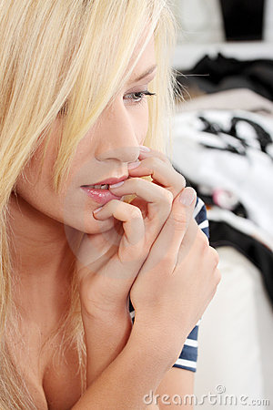 Young woman biting nails