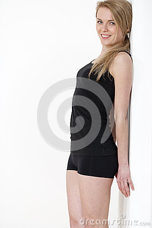 Young woman in black fitness wear