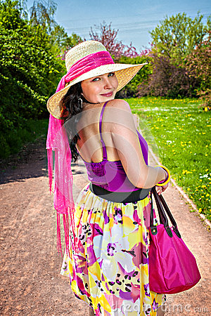 Young woman with black hair in summer straw hat