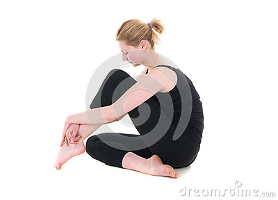 Young woman in black leotard sitting