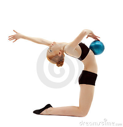 Young woman in black posing with gymnastic ball