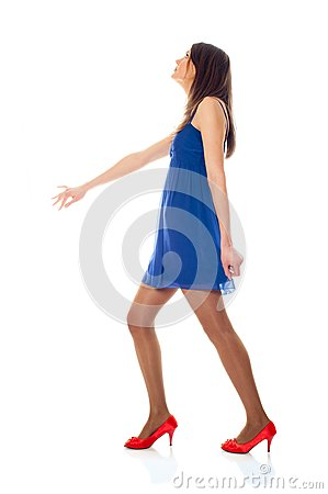 Young woman with blue dress and red shoes