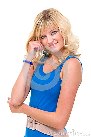 Young woman in blue dress smiling