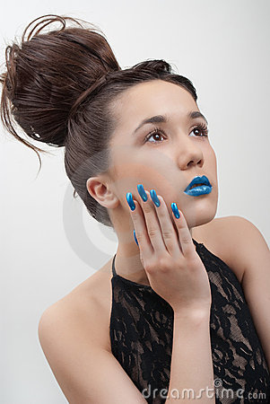 Young woman with blue lips and nails