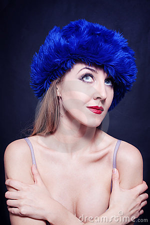 Young woman in blue winter hat