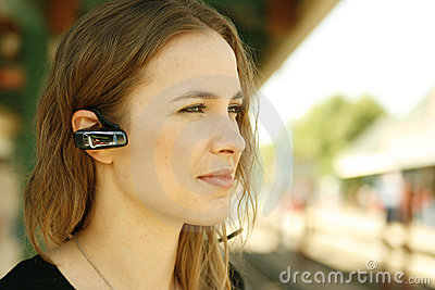Young woman bluetooth headset