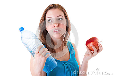 Young woman with bottle of water and apple