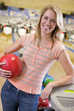 Young woman in a bowling ally