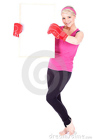 Young woman in boxing gloves with blank card