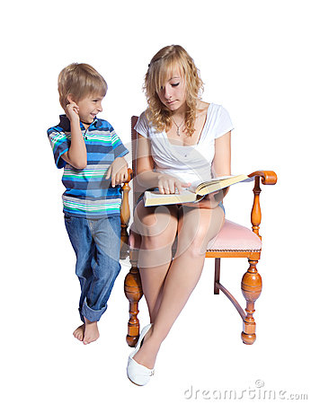 Young woman and boy reading a book.