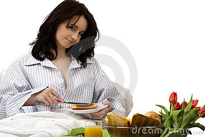 Young woman with breakfast in bed