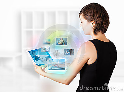 Young woman browsing pictures on modern tablet