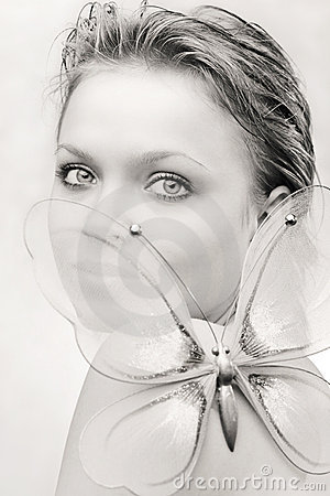 Young woman with a butterfly