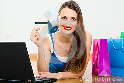 Young woman buying in the Internet