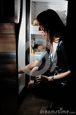 Free Young Woman By A Fridge Stock Photos - 25002933