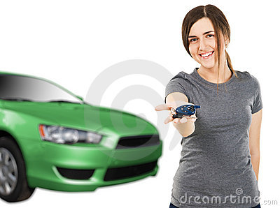 Young woman with car keys and new auto