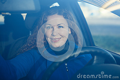 Young woman in car preparing to driving