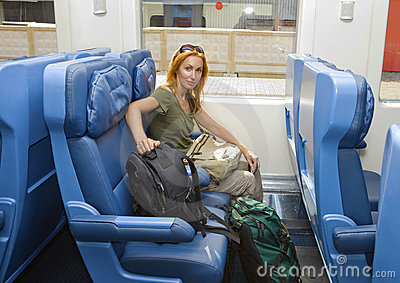 Young woman in car of train