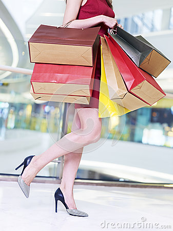 Free Young Woman Carrying Colorful Paper Bags Walking In Shopping Mal Stock Photos - 78180583