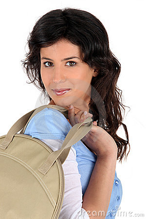 Young woman carrying a handbag