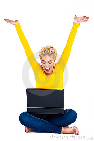 Young Woman Celebrating Success on Laptop
