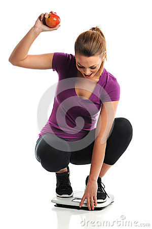 Young Woman Celebrating Weight Loss