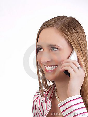 Young woman with cell phone to ear smiling