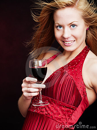 Young woman with champagne over dark