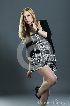 Young woman in checked dress