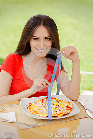 Free Young Woman Checks On Pizza Size With Measuring Tape Stock Image - 51169201
