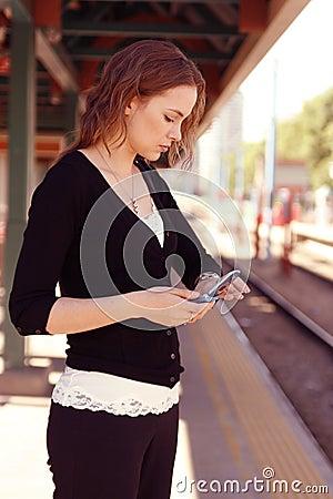 Young woman checks watch