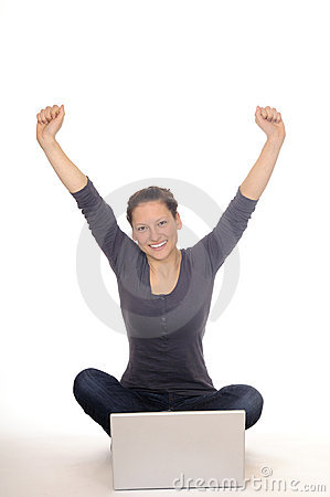 Young woman cheering at laptop